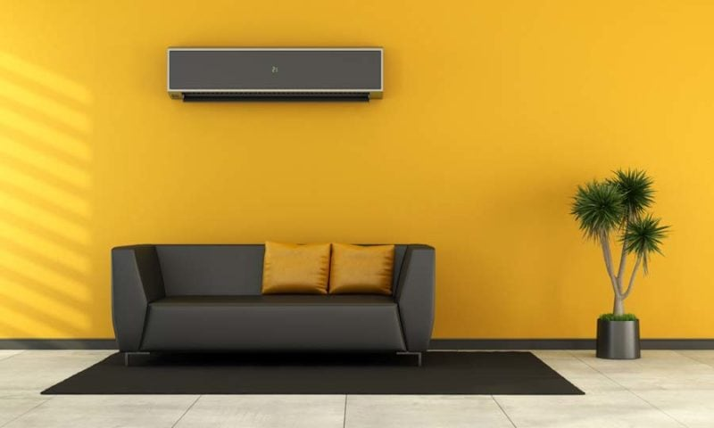 Modern living room with black couch and ductless air conditioner on wall - rendering